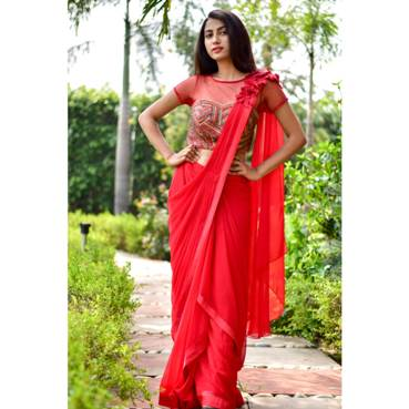 Renowned designer Mithi Kalra plays with Red Hues in her latest bridal collection,